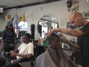 A white man in a black shop