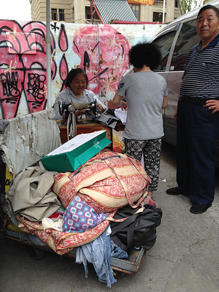 sewing in the street
